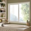 horizontal slider window next to a large bathtub