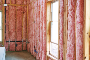 pink fiberglass batt insulation installed in walls